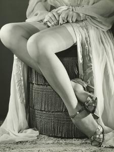 Woman Adjusting Stockings, Low Section by George Marks