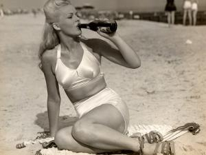 Woman in Swimsuit Having a Soda by George Marks
