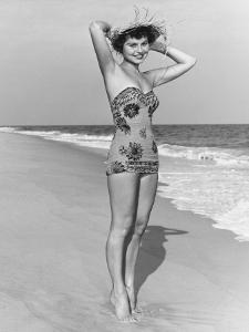 Woman in Swimsuit Posing on Beach, Portrait by George Marks