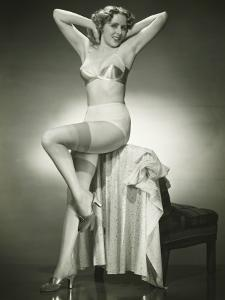 Woman in Underwear and Stockings Posing in Studio, Portrait by George Marks