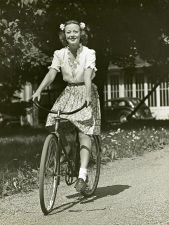 Woman on Bike by George Marks