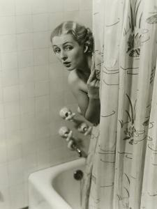 Woman Peeking From Behind Shower Curtain by George Marks