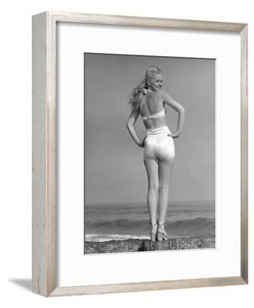 Woman Posing on the Beach in Bathing Suit