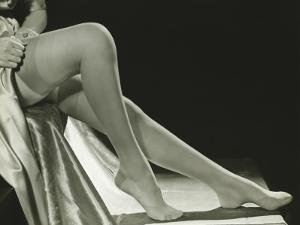 Woman Pulling on Stockings, Low Section by George Marks
