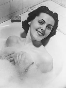 Woman Taking Bath in Bathtub by George Marks