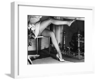 Woman Wearing Stockings Sitting By Fireplace