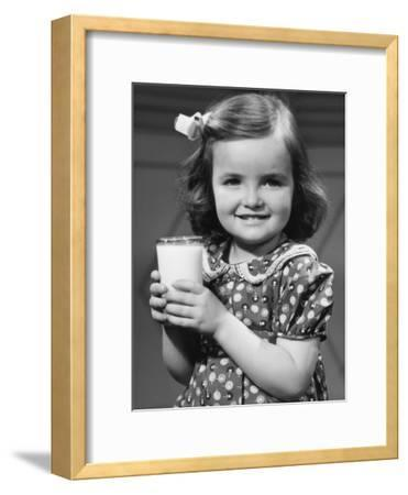 Young Girl Holding Glass of Milk