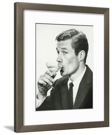 Young Man in Suit, Drinking Wine