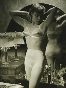 Young Woman in Underwear Standing By Mirror by George Marks