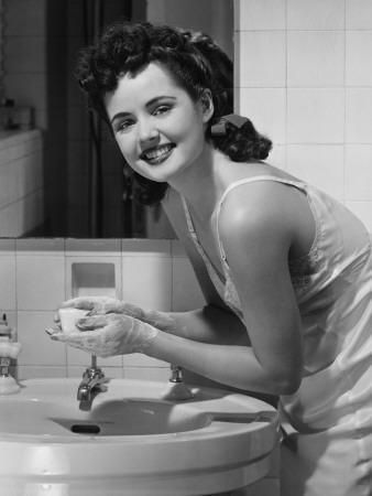 Young Woman Washing Hands in Bathroom, Portrait