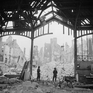 Destruction Visible During Allied Campaign to Liberate Caen During WWII by George Rodger