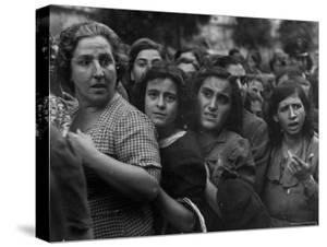Hungry Italians Waiting For Their Bread Allotment Following Allied Takeover of Naples During WWII by George Rodger