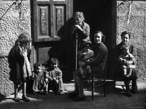 Italian Women and Children Left to Fend for Themselves After Germans Took Their Men for Labor by George Rodger