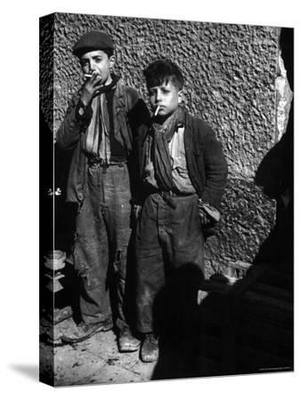 Ragged, Filthy, Poverty Stricken, Street Boys Smoking Cigarettes Begged from American Soldiers