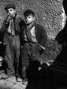 Ragged, Filthy, Poverty Stricken, Street Boys Smoking Cigarettes Begged from American Soldiers by George Rodger