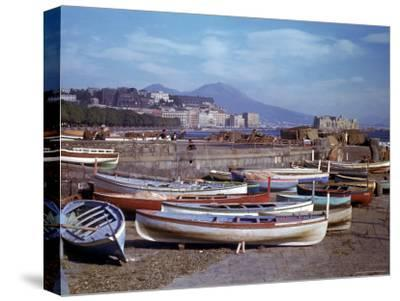 Small Fishing Boats on the Shore of Naples Harbor During WWII
