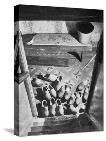 Wooden Shoes in a Hallway at the Bottom of the Stairs