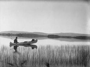 Canoeist on Sandy Lake by George Shiras