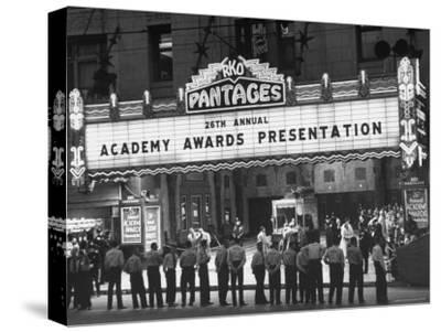 Attendants in Front of Pantages Theater Await Celebrities to Arrive for 26th Annual Academy Awards