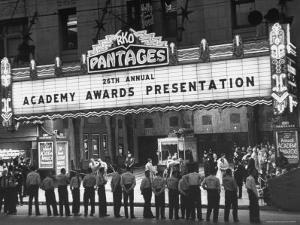 Attendants in Front of Pantages Theater Await Celebrities to Arrive for 26th Annual Academy Awards by George Silk