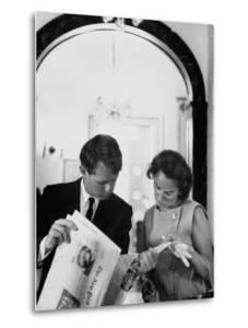Attorney General Robert Kennedy and Wife Looking at Copy of the New York Times by George Silk