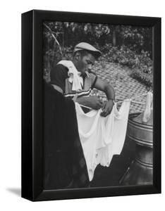 Boxer Floyd Patterson Doing Laundry at Training Quarters Near Newtown by George Silk