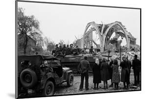 British 49th Armoured Personnel Carrier Regiment Tank Passes Civilians and a Damaged Church by George Silk