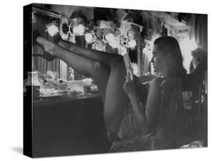 Chorus Girl-Singer Linda Lombard, Resting Her Legs after a Tough Night on Stage by George Silk