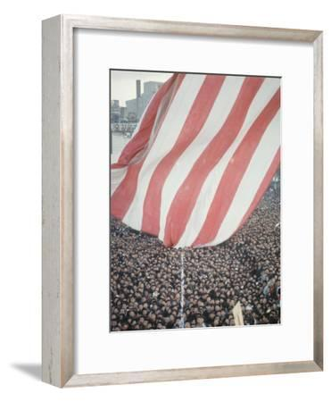 Giant American Flag Flying over a Large Crowd During President Johnson's Asia Tour