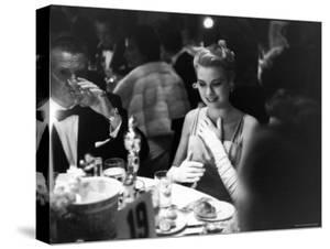 Grace Kelly Sitting at Romanoff's by George Silk
