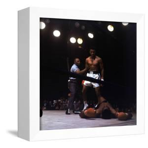 Heavyweight Boxer Cassius Clay, aka Muhammad Ali, Standing over Opponent Sonny Liston by George Silk