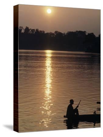 Man on Boat on River Near Dr. Albert Schweitzer's Compound at Lambarene