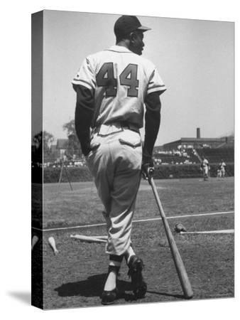 Milwaukee Braves Hank Aaron Leaning on Bat During Baseball Game