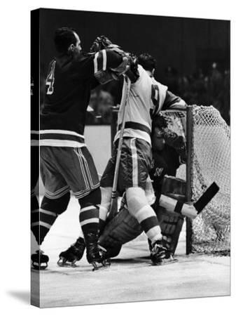 Ranger Goalie Jack McCarran and Detroit Red Wings Gordie Howie During Game