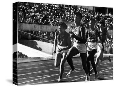 Russian Runner, Irina Press with Us Sprinter Wilma Rudolph in Women's Relay Race at Olympics