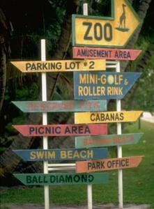 Signs Pointing Every Which Way, Key Biscayne, Florida by George Silk
