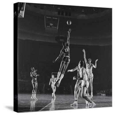 University of Kansas Basketball Player Wilt Chamberlain (C) Playing in a School Game, 1957