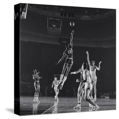 University of Kansas Basketball Player Wilt Chamberlain (C) Playing in a School Game, 1957
