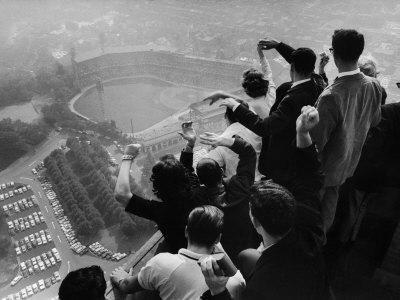 University of Pittsburgh Students Cheering Wildly from Atop Cathedral of Learning, School's Campus
