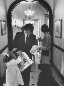 US Attorney General Bobby Kennedy Browsing Copy of the NY Times with daughter and Wife by George Silk