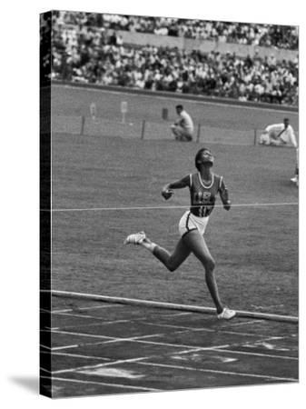 US Sprinter, Wilma Rudolph, Winning Women's 100 Meter Dash in Olympics
