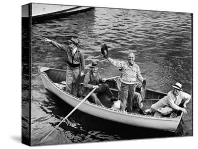 President Harry S. Truman Standing in Rowboat, Fishing with Others