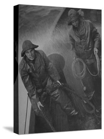 Naval Officers Working on a Ship During a Storm