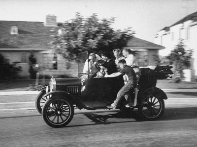 George Sutton and His Family Riding on a 1921 Model T Ford-Ralph Crane-Photographic Print