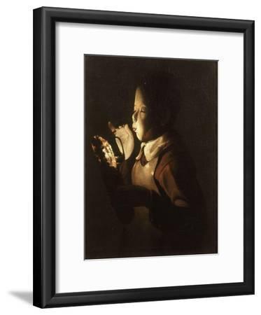 Boy Blowing at Lamp