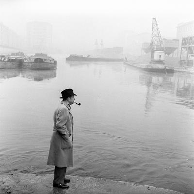 Georges Simenon Smoking a Pipe by the Navigli in Milan--Photographic Print