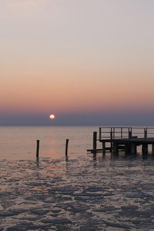 Sunset and Jetty in Podersdorf Am See, Frozen Lake Neusiedl, Burgenland, Austria, Europe
