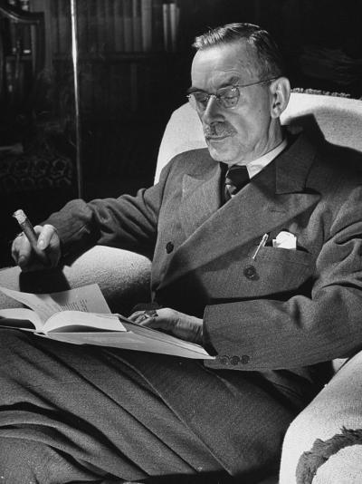 German-Born Writer Thomas Mann Reading a Book at Home-Carl Mydans-Premium Photographic Print