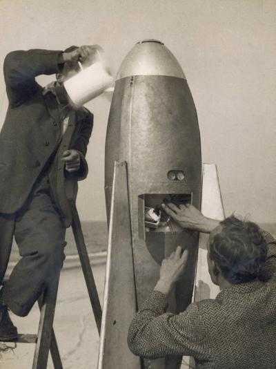 German Rocket Experiments on a Windswept Spit of Land, Filling the Device with Its Chemical Fuel--Photographic Print