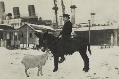 German Sailor on Donkey, with Goat in Village During the Winter-George Warming-Photographic Print
